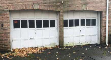 Before: The old wooden garage door